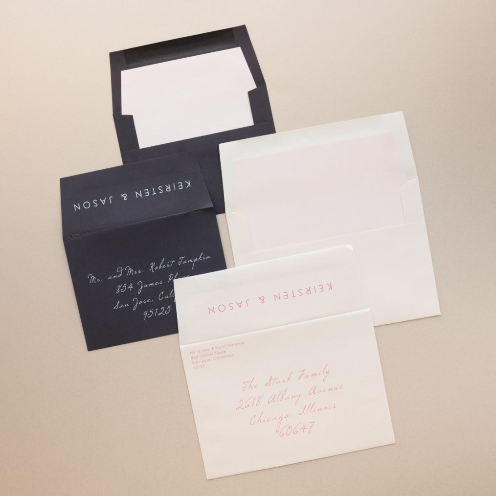 Champagne, blush and dark gray wedding invitation envelopes